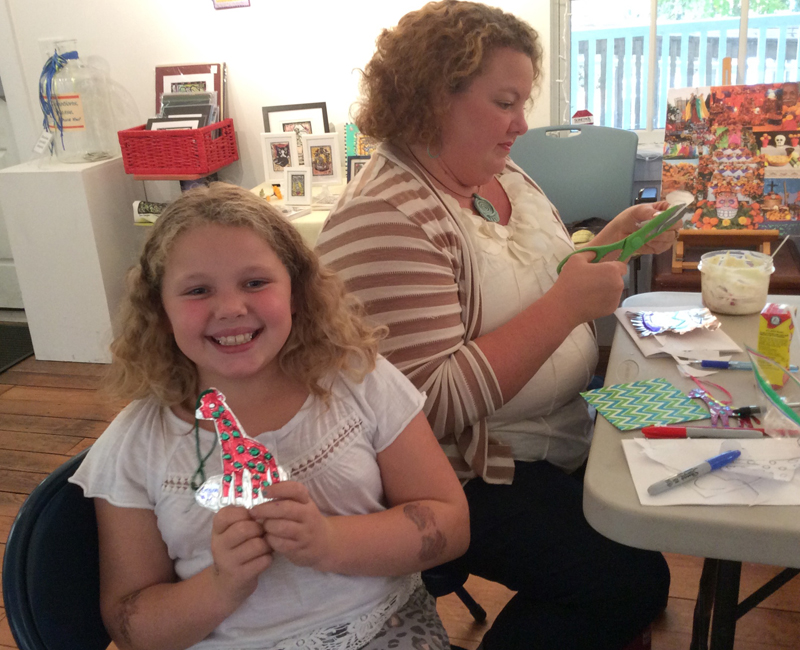 Grace and her mom with her Mexican cut tin ornament